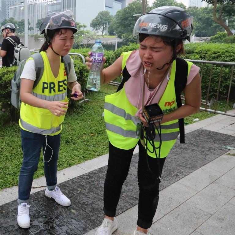 periodistas-de-Hong-Kong-Holmes-protestas-manifestantes-